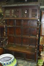 Unusual Early 20th Century Oak Hall Settle, with astragal cabinet section & shelf on turned supports, above a hinged seat compartment
