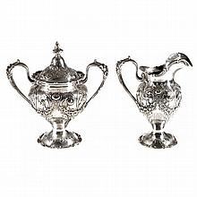 An American sterling silver covered sugar bowl and creamer with Rococo decoration, numbered 17146.