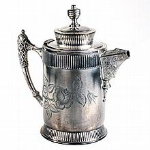 A Britannia metal hot water jug of cylindrical form engraved with a rose.