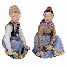 A pair of Royal Copenhagen figures titled 'Amager' and 'Fano' designed by Carl Martin-Hansen, 1906-1925.