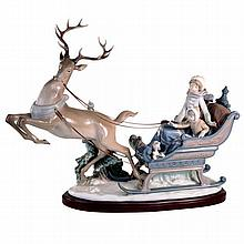 A Lladro figural group of mother and child in a sleigh pulled by a reindeer, printed and impressed marks to base.