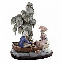 A Lladro figural group of a family in a rowboat with attendant goats, printed and incised marks to base.