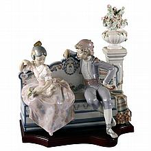 A Lladro figural group of a courting couple on a bench. Reference no. 1518, printed and impressed marks to base.