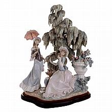 A large Lladro figural group of two women beside a willow tree, printed, impressed and incised marks to base.