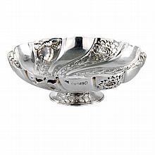 A Victorian silver embossed and footed bon bon dish with swirling floral design, SW Smith, London 1887.