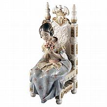 A Lladro figure of a young girl on a throne holding a bunch of roses, printed marks to base.