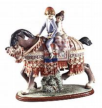 A Lladro figural group of two children on a draped horse, printed and impressed marks to base.