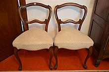 A Set of Four Period Well Upholstered Dining Room Chairs. Scroll work backs above Cabriole legs to front. -