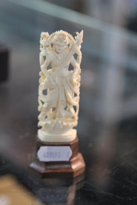 Ivory Carved Deity on Stand
