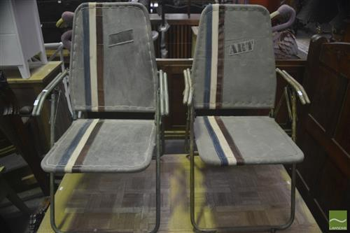 A pair of military style folding campaign chairs