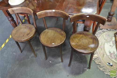 A set of three timber dining chairsRFilm Provenance; Australia, 2008