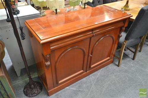 A Late Victorian Sideboard with Two Frieze Drawers of Two Arch Panel Doors with key