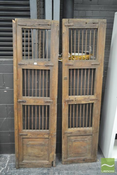 Pair Of Timber Doors With Metal Rod Windows