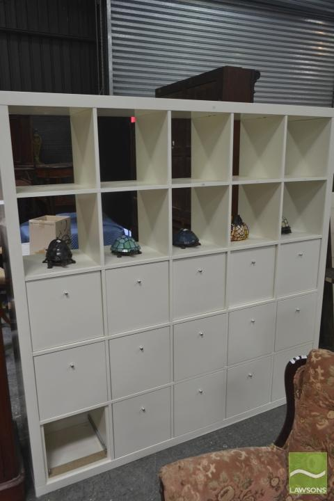 A white painted shelving unit, with 10 shelves, 15 drawers, 185 x 185cmROne drawer missing