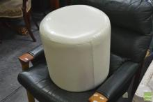 A Nest of Two Leather Ottomans