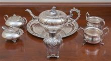 A group of silverplated wares including a teapot, various sugar basins, milk jugs and a tray
