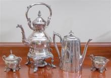 A silver plated kettle on stand with burner and plated coffee pot. Height of tallest is 38cm. Together with an EP sugar and creamer.