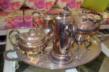 A group of EP tea and coffee pots plus kettled with burner on a large twin handled footed tray. Length of tray 80cm.