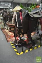 Male and Female Dressage Saddles on stands with accessories