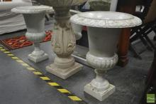 Pair of White Cast Iron Urns