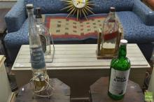 Collection of Bottles on Swing Stands