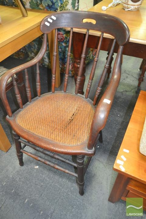 Timber Tub Chair with Spindle Back and Rattan Seat (damage to seat)