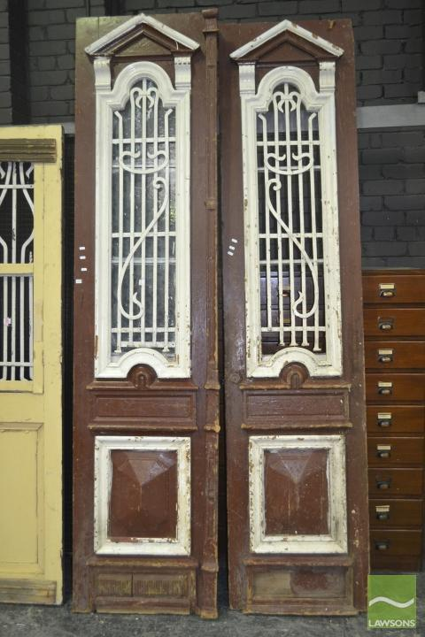 Tall Pair of Brown Painted Timber Doors with iron inserts