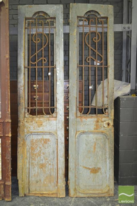 Tall Pair of Rustic Timber Doors with iron inserts