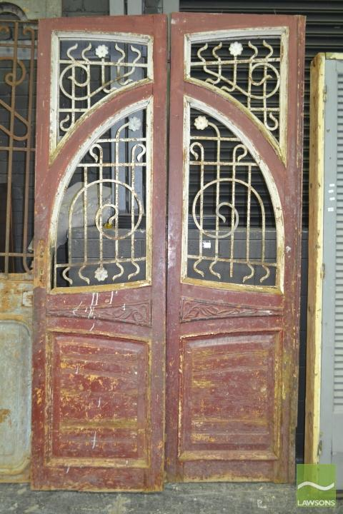 Tall Pair of Timber Doors with scrolled iron inserts