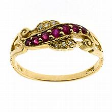 A 9CT GOLD GYPSY RING; scroll top set with rubies and round brilliant cut diamonds. Size O.