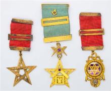 THREE 9CT GOLD MASONIC BREAST JEWELLS BY HAMMERTON & BLASHKI; each with 3 bars and symbolic pendants, wt. 52.2g.