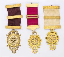 THREE STERLING SILVER GILT MASONIC BREAST JEWELLS BY BLASHKI; each with 3 bars and a symbolic pendants.