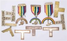 A GROUP OF MASONIC REGALIA; 3 breast jewels, a collar badge and 7 apron plates, most in sterling silver by Blanshki.