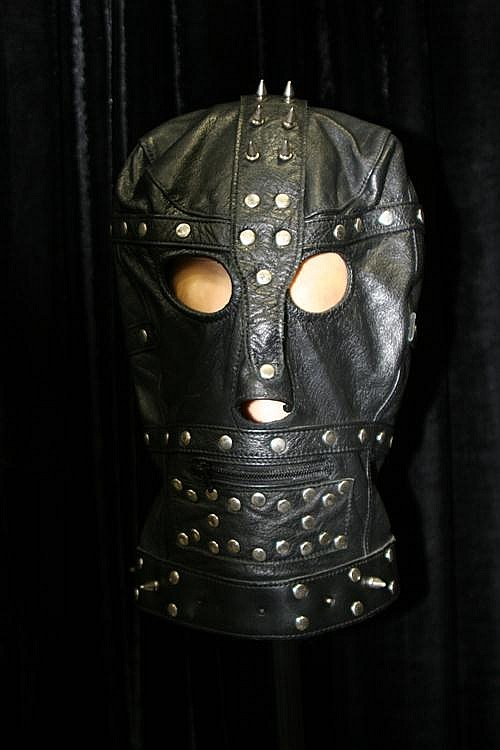 Leather studded hood on stand