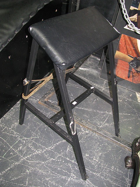 An angular stool with a strap