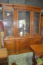 Late Victorian Oak Breakfront Bookcase, with three glass panel doors (centre pane cracked), flanked by columns, with three panel doo...