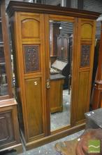 Late Victorian Walnut Wardrobe, with mirror panel door, flanked by carved floral panels