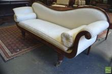 A Mid 19th Century Cedar Double Ended Settee with loose cream cushions on turned faceted legs.