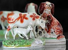 Staffordshire Figure of Cow with Calf and a Spaniel Group