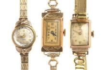 THREE ASSORTED LADY'S VINTAGE WATCHES; 2 in 9ct gold by Tudor and Angus Coote (both working), and a Cyprus (not working), all with m...