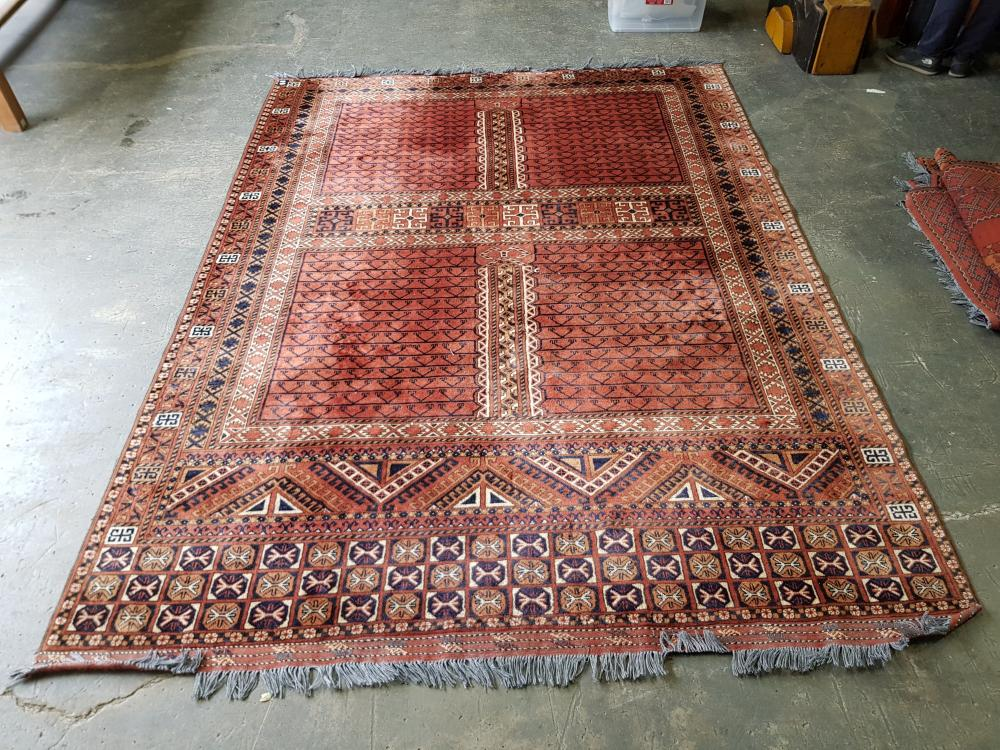 Afghan Turkoman Ensi Wool Carpet, divided into four fields, with triangular end & geometric frame, predominantly red colour (292 x 1...