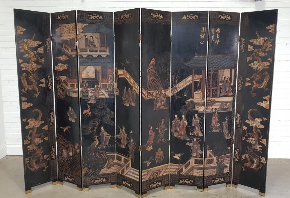 Large Chinese Carved & Coloured Lacquer Eight Panel Screen, with courtiers in an idyllic garden setting, flanked by end panels with...