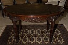 A Superior Quality Mahogany Centre Table. The oval top with original variegated olive leather with blind Greek Key edge banding. The...