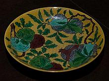 UNUSUAL CHINESE YELLOW GROUND INCISED DRAGON 'POMEGRANATE' DISH,  the interior decorated with fruiting pomegranate branches agains...