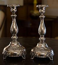 A pair of Hallmarked silver tall candle sticks.C. Early 1900's