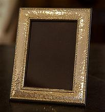 A Sterling Silver photo frame with hammertone finish; 140mm x 180mm