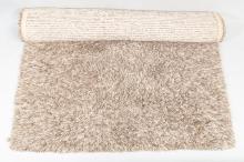 Lot 1037: A contemporary shag-pile mushroom coloured woollen rug, W x 200cm, L x 300cm