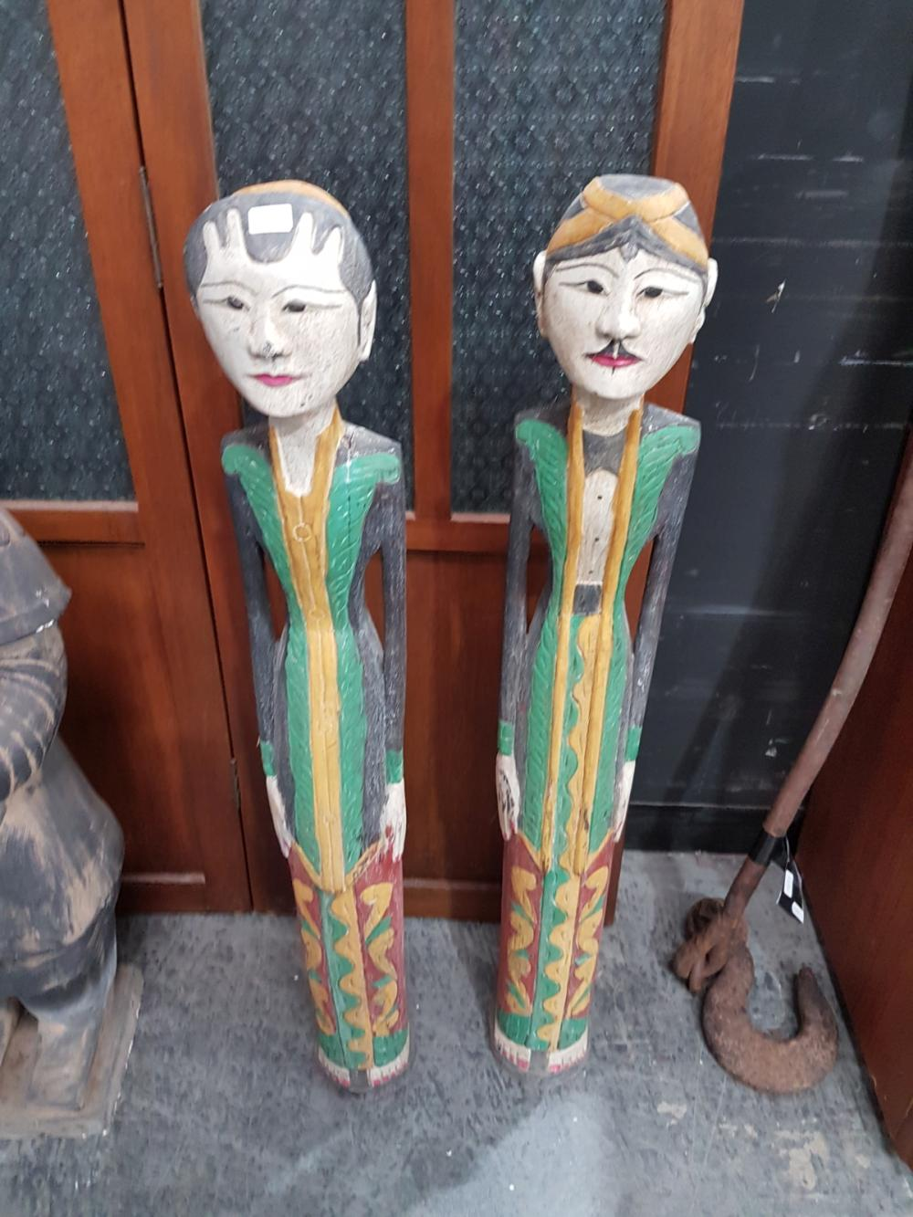 Pair of Carved and Polychrome Indonesian Figures -