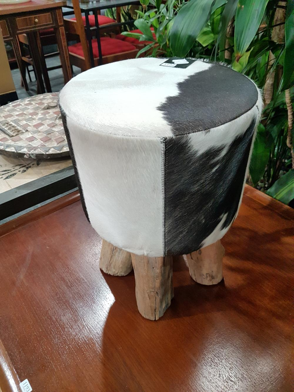 Modern Cow Hide Upholstered Stool on Timber Legs