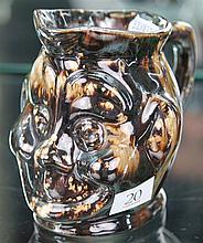 John Campbell Brown Glaze Figural Jug, Height - 12cm